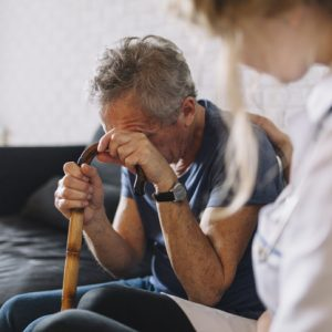 crying-man-in-nursing-home-625x417
